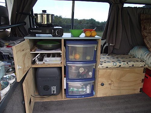 Van kitchen. I think I could make this look a little bit less....rustic, couldn't you? but in a van or a 5x8 trailer this might be all the room your kitchen and seating (see the bed next to that?) would allow.