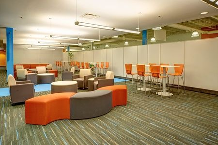 Colorful break room at Allied Global with Artopex office lounge furniture.