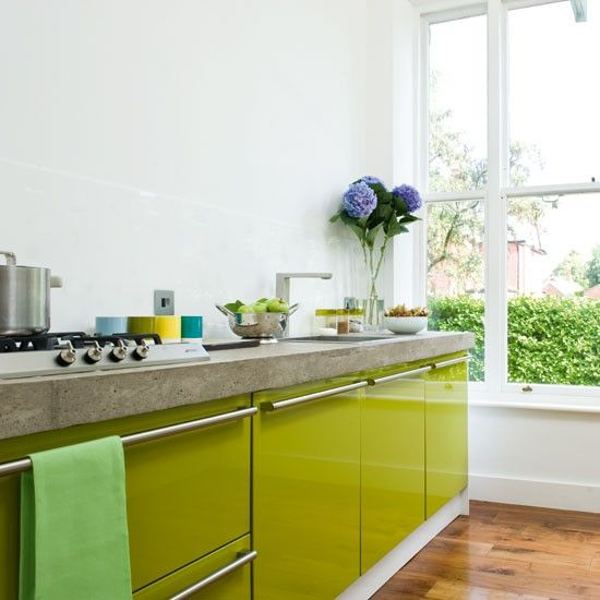 Galley layout | A contemporary lime green kitchen (to the front)
