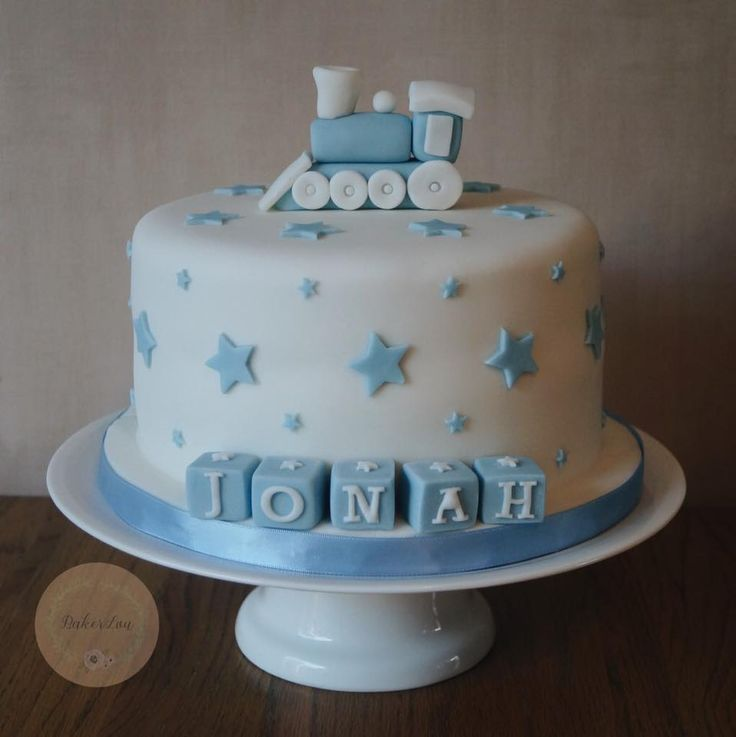 Cute train cake for a baby boy's christening with blue baby blocks
