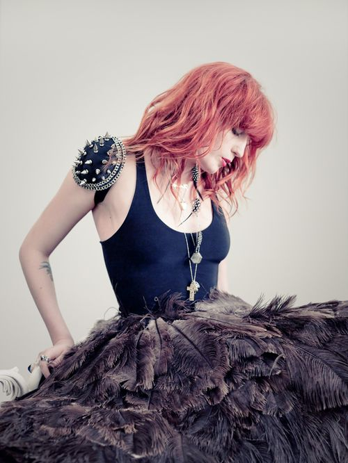 Florence has fantabulous hair...and an ostrich feather skirt!