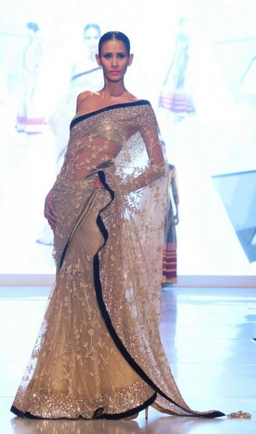 absolutely stunning sari with transparent silver embroidery and black border, go to blossomboxjewelry.com for accessories