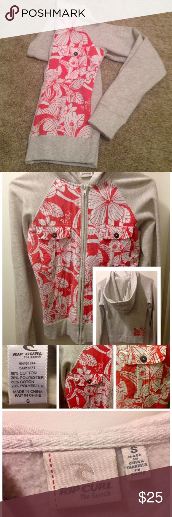 Rip Curl light gray floral zip up hoodie Gently used great condition, used once. Two button up pockets in front and two side double hand pockets. Graphics in front and graphic patch on back side. Rip Curl Tops Sweatshirts & Hoodies