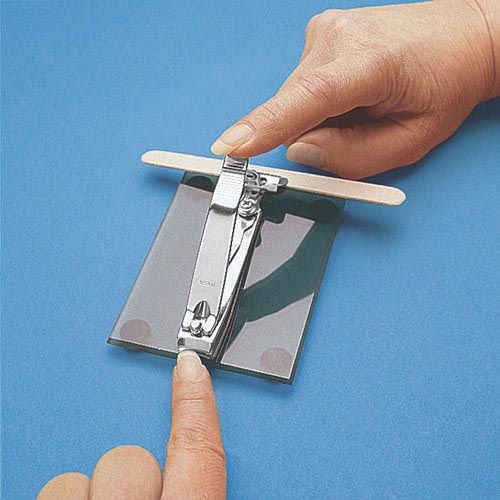 This is an adapted finger nail clipper. This device is beneficial because it does not require grasp strength of the finger nail clippers, which may be difficult for adolescents to perform when they have grip strength issues. Independently performing grooming and personal hygiene tasks are important components of becoming an independent person and transitioning into adulthood. This adaptive device will promote that independence. No pricing was available.