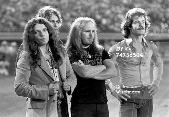 "Rossington formed the band ""The Noble Five"" as a teenager with friends Ronnie Van Zant, Allen Collins, Larry Junstrom and Bob Burns in the summer of 1964. They would later change the name of the band to ""The One Percent"" before becoming Lynyrd Skynyrd. Skynyrd gained national exposure starting in 1973 with the release of their first album (pronounced 'lĕh-'nérd 'skin-'nérd) and hit single ""Free Bird""."