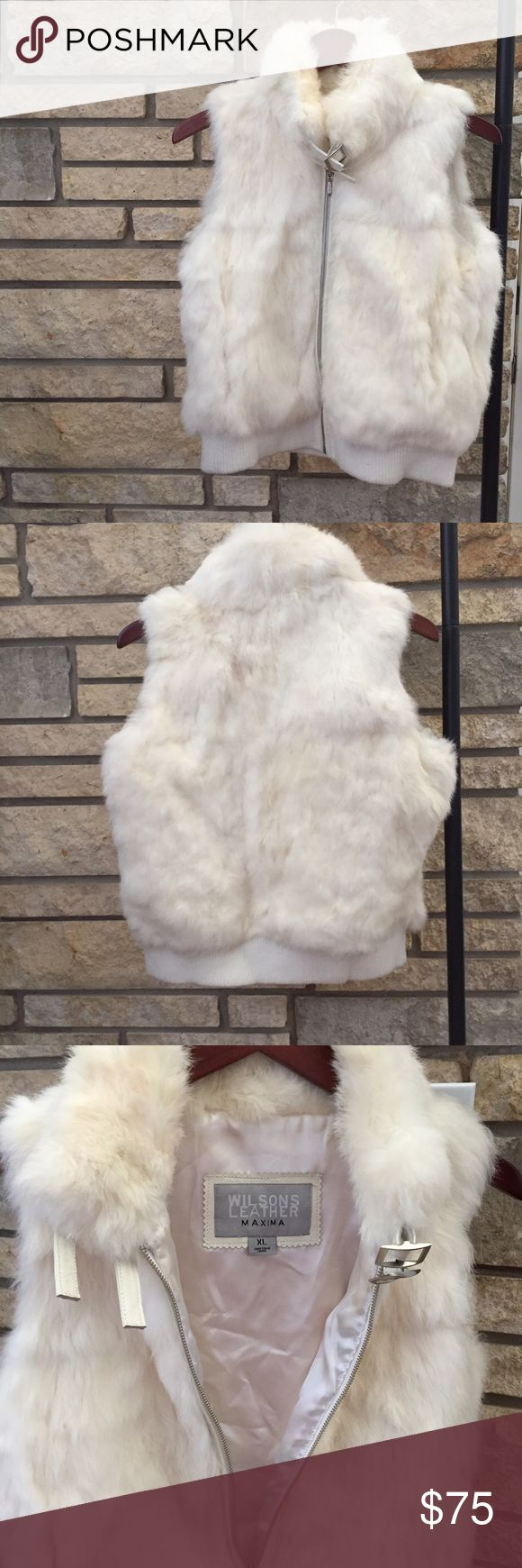 Rabbit fur vest White rabbit fur vest, size XL, EUC. Satin lining, two leather and silver trimmed buckles at the neck. I bought this years ago, and I've only worn it a few times. It's gorgeous and wonderfully soft! Wilsons Leather Jackets & Coats Vests