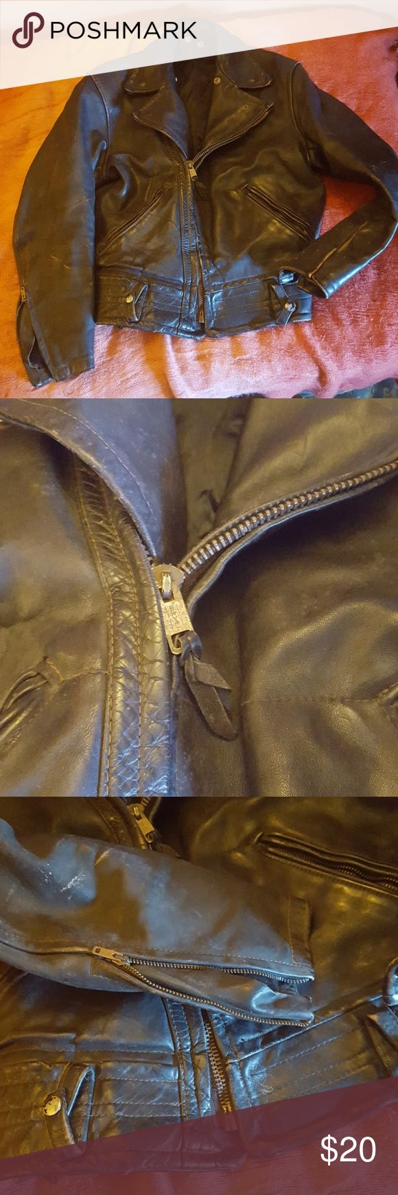 """SUPER Vintage Leather Moto Jacket *Has damage* Ok. This thing is OOOLD. Like, super old. It was old BEFORE I had it forever kinda old. I'm thinking 50's era. The leather is distressed. It smells like an old car (always has). The zippers and snaps are still working and functional. The leather is still sturdy and awesome. The DAMAGE is an approximate 6"""" split in the seam on the right sleeve. An easy fix if you have the right kind of needle. Size Medium. 20"""" pit to pit, 16"""" waist lying flat…"""