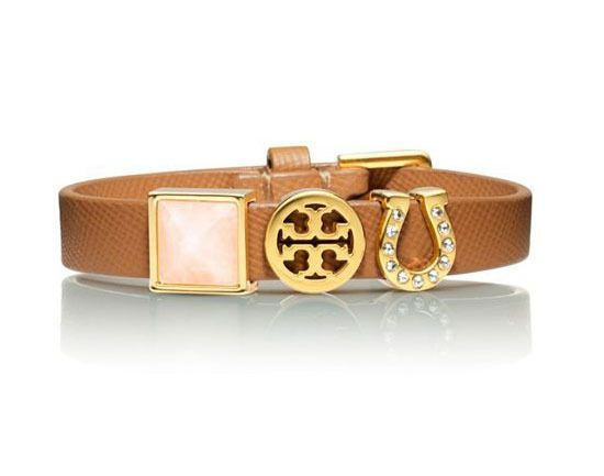 Childish charm bracelets get a chic twist with this Tory Burch bracelet. $85.00 at Tory Burch. Read more at http://michiganavemag.com/the-latest/style-and-beauty/postings/chic-lucky-charms-to-wear-on-st-patricks-day#YyszWTd2SYyJppGC.99