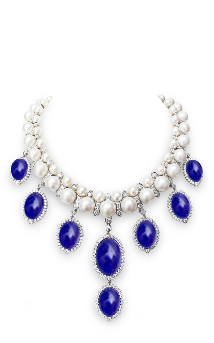 FARAH KHAN FINE JEWELRY Contemporary Couture Necklace. Rendered in white gold, these statement necklace by Farah Khan features large tanzanite droplets embellished with white glistening diamonds and rubies.  Lobster closure 18K White Gold, 116.7g White Diamond,17.39 cts Tanzanite, 275.73 cts South Sea Pearl, 428.0 cts Made in India. $76,800 ($38,400 deposit)