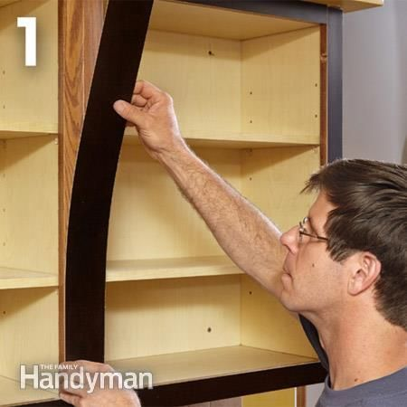 The first step in cabinet refacing is covering the edges with veneer.
