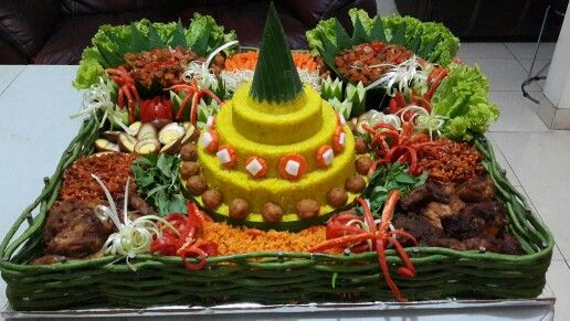 Indonesian called this : Nasi Tumpeng.. Rice with coconut milk and saffron, and various side dish such as Perkedel (fried mashed potato), Ayam Panggang (Baked chicken with spicy flavor), Urap (boiled vegetables with coconut flakes), Telur Pindang (egg with soysauce), Sambal goreng kentang ati