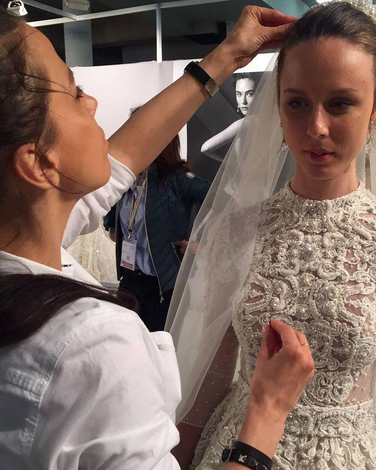 Ersa Atelier designer Gabriela Antonescu puts on the finishing touches on Euphemia wedding dress.