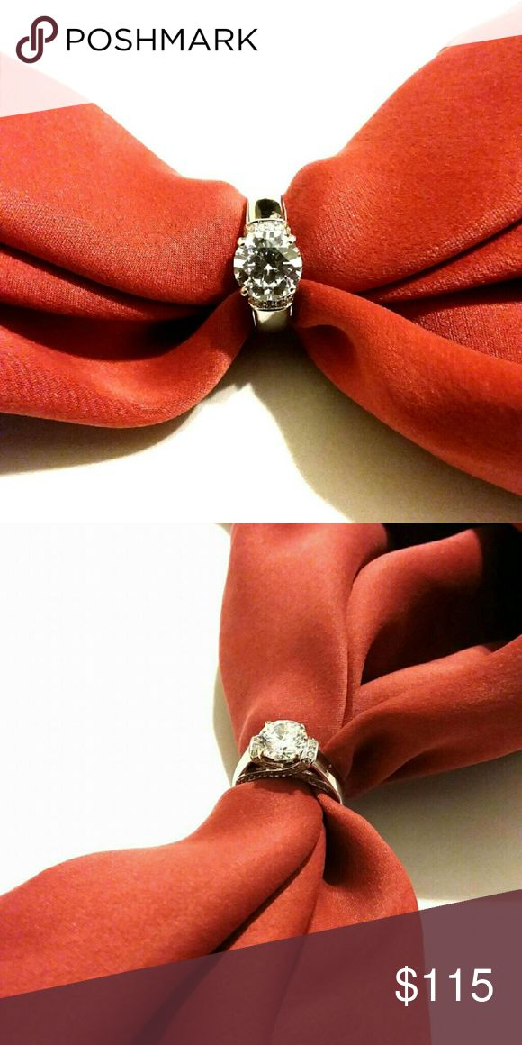 Genuine 925 Sterling Silver Engagement Ring Made from high quality genuine 925 Sterling Silver Comes with a beautiful red velvet box  Size 7 Jewelry Rings
