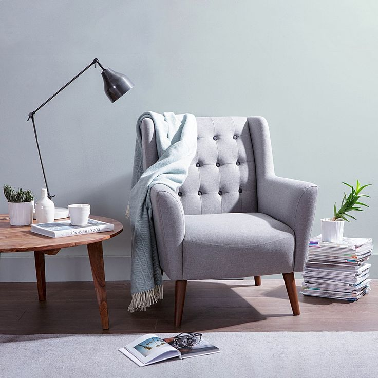 Exude mid-century style when you recline in the refined comfort of the classic Abel Light Grey Black Button Armchair from Zanui.