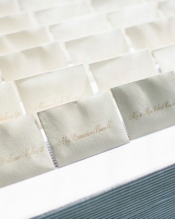 Calligraphed envelopes serving as escort cards