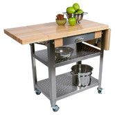 Found it at Wayfair.ca - Leduc Kitchen Cart with Wood Top