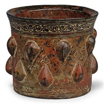 A BRONZE MORTAR  AFGHANISTAN OR KHORASSAN (CENTRAL IRAN), 12TH CENTURY  probably Khorassan or Iran, circa 10th century, heavily corroded and encrusted The mortar 5¼ in. (13.5 cm.) diam. Price Realized   £2,375 ($3,829)
