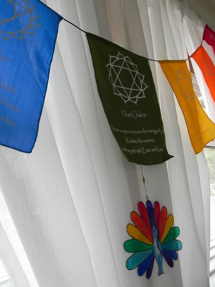 www.organiqueearthspa.com.au Organique Earth Spa - Mornington Day Spa experience. Chakra flags radiate colour and energy, whilst they dance in the breeze in our clinic...