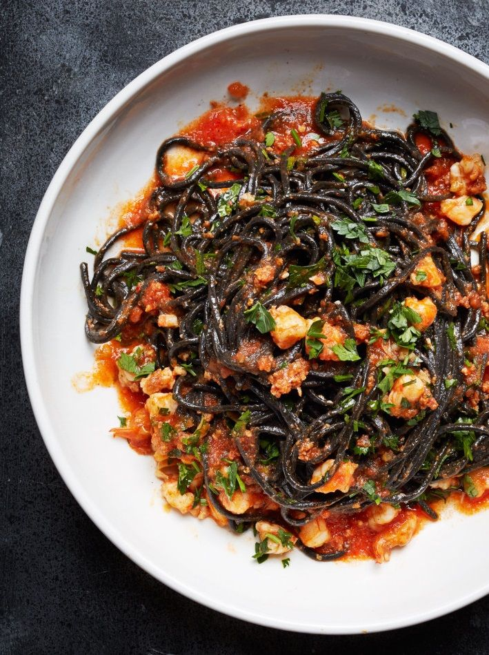 "SQUID INK PASTA with SHRIMP, NDUJA & TOMATO ~~ nduja is a calabrian spreadable sausage (pork shoulder. belly, tripe, roasted pepper, spices). this recipe is taken from an article titled, ""how to make pasta in 2015: the new rules of pasta"". a direct link to the rigatoni dish can be found at this post's link. the main article (with additional recipes) is at http://www.bonappetit.com/test-kitchen/ingredients/article/new-rules-of-pasta [Italy, Regional Calabria Modern] [bonappetit] [shrimp…"