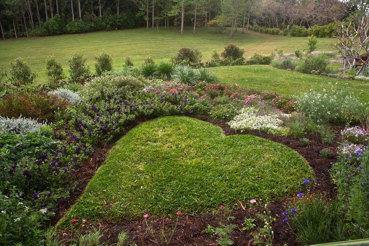 Lawn for cuddling in a flower garden