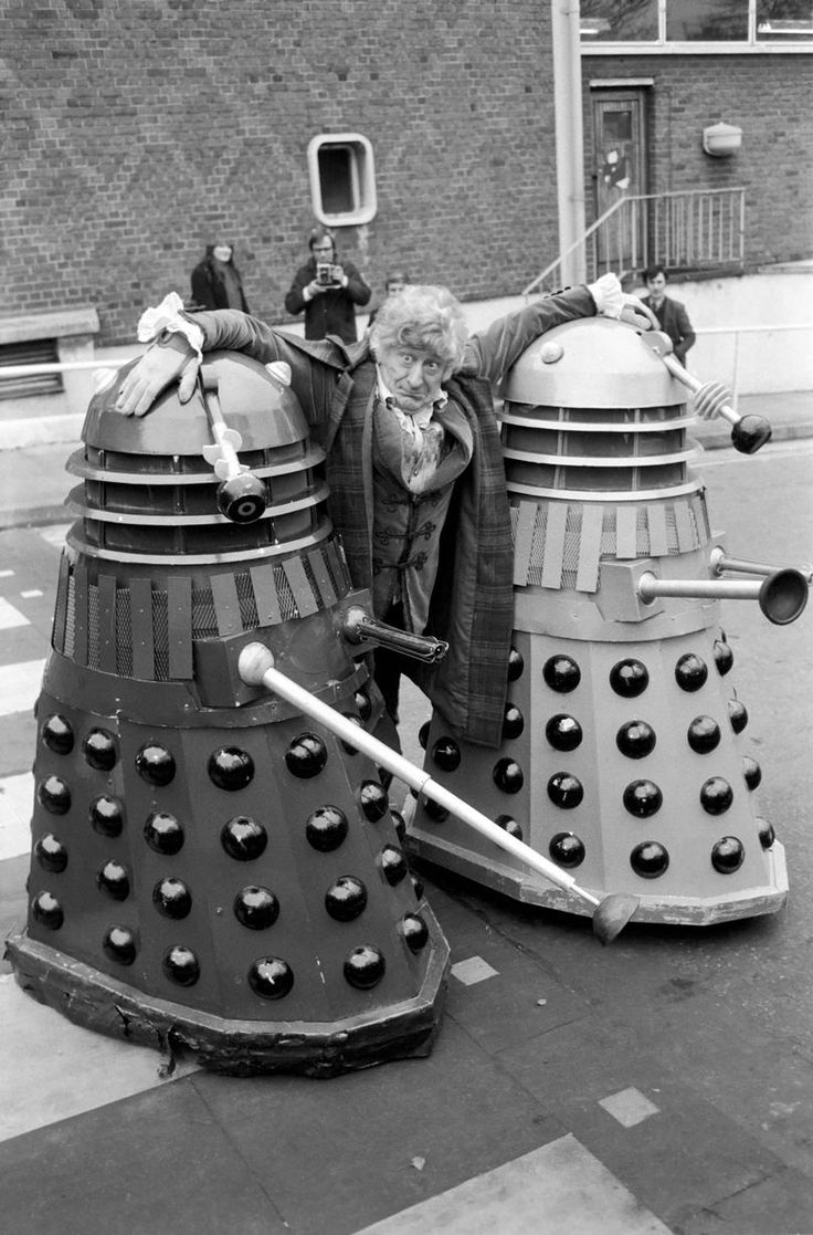 """Jon Pertwee with Daleks, 1971: They're Doctor Who's most feared and famous enemy but even Daleks need a hug sometimes. These two are taking a break from screeching """"Exterminate!"""" to pose with the dandyish Pertwee (father of movie star Sean). That series marked the return of the Daleks to the show after five years."""