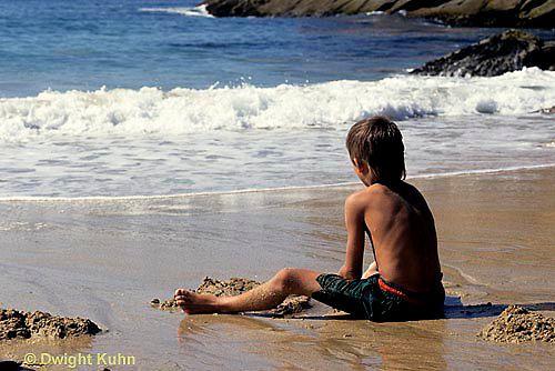 Sandcastles  ON03-033z  Ocean - boy sitting on sandy beach watching waves breaking
