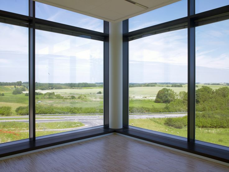 Our ProLine Convection Grilles are mounted in the floor in front of glazing units, protecting efficiently against cold downdraught. This solution is from the Danish company MediCult in Måløv. And what a view! #proline #heating #radiators #heatingsolutions #medicult #landscape