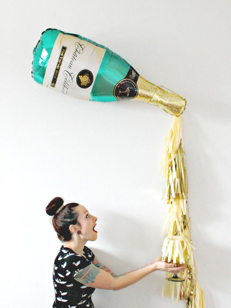 Style a giant champagne and tassel bachelorette or bridal shower ballon for party decor that makes for adorable photo ops!