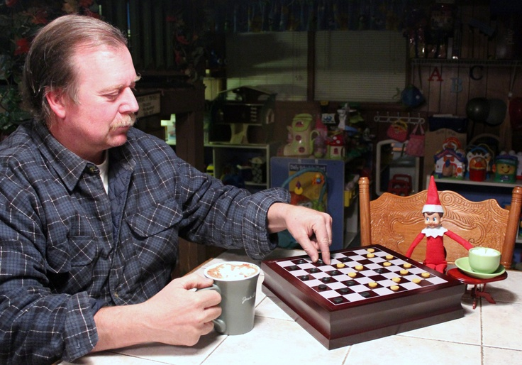 Both of my men warming up after some outside time in the snow.... Ummmmm some nice hot cocoa and a game of checkers. :)