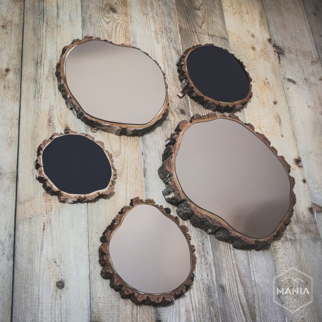 Composotion of mirrors put on wood slices. Great fusion with natural shapes of wood. #cooper #wood #black #mirror #slices