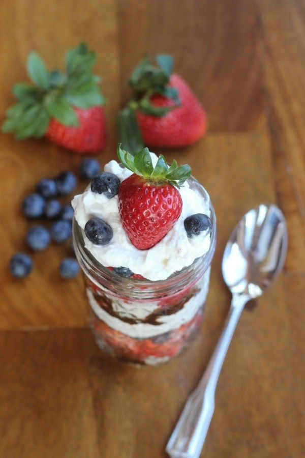 A wonderful fruit based mason jar dessert. With fruit, whipped cream and CHOCOLATE!  Perfect when you want a dessert that is RED, WHITE & BLUE! - Momcrieff.com