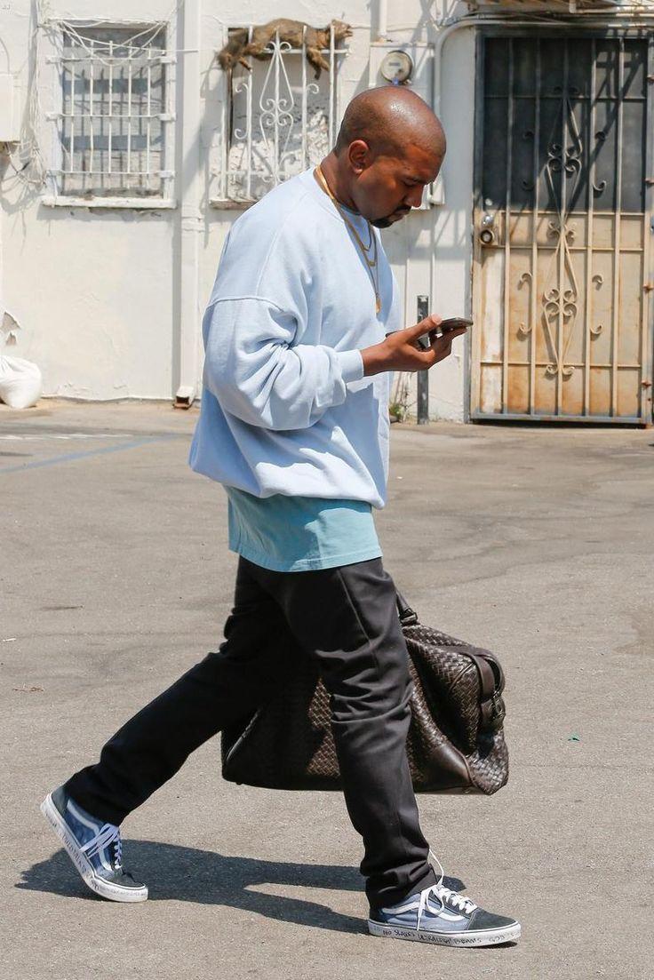Kanye West wearing Bottega Veneta Intrecciato Leather Holdall and Vans Old Skool Sneakers in Navy