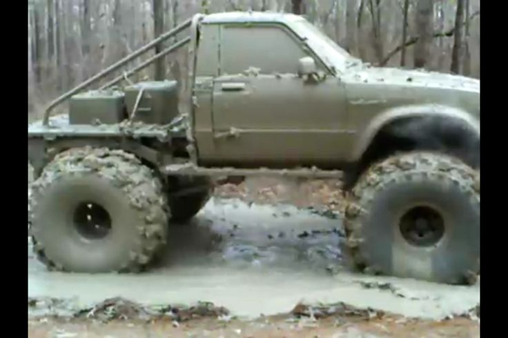 """'83 toyota with a cummins turbo diesel, flatbed, and 40"""" (i think) swampers."""