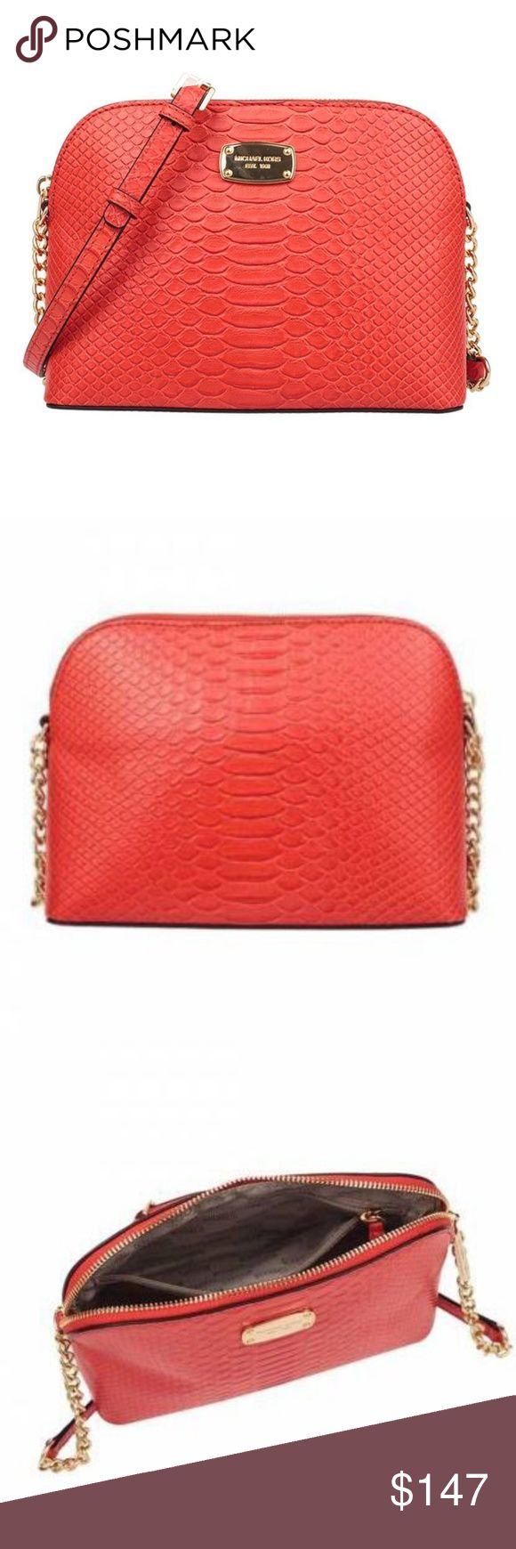"""Michael Kors Cindy Mandarin Embossed Crossbody Bag Michael Kors Cindy Mandarin Embossed Leather Large Crossbody Bag  item# 273006549509  100% Authentic Michael Kors!  Buy with confidence!  • MSRP: $268,00  • Style: 35T7GCPC3E  Features:  • Made of embossed Python leather with logo detail in front  • Top zip closure  • Open compartment with 1 zip pocket and 1 open pockets  • Adjustable crossbody 22""""-24"""" drop  • Dimensions: 8.75""""L X 7""""H X 3.5""""D  • Gold tone hardware  • Imported  Please feel…"""