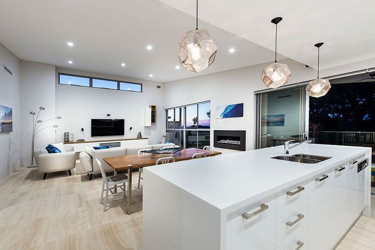 Different layers of lighting combine to create a cheerful living area
