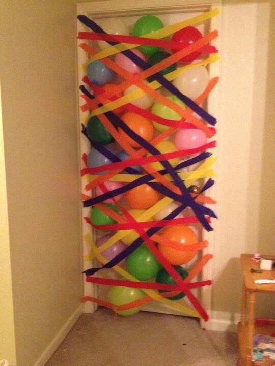 Birthday balloon avalanche! Door opens from inside then climb through crepe paper to get out!
