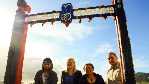 Bryce Woollam, Rachel Clothier-Simmonds (principal), Jay Simmonds and William Theodore are proud of the new carved ...