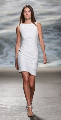 SONYA:  This pure white open weave boucle fitted Rolando Santana dress is irresistibly feminine. The embellished front neckline of this piece gives it a delicate finish and makes it a perfect piece for the summer. Elegance has never been this easy! $2095