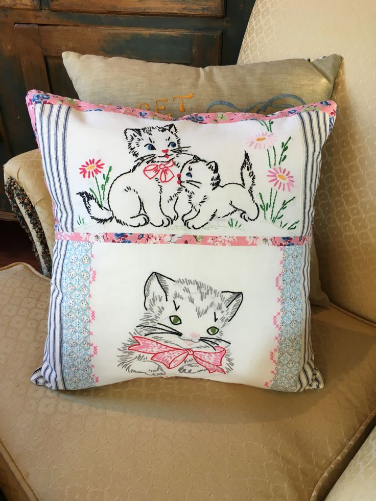 I made a pillow with bits of vintage embroidery, all cats! Even the blue fabric is cat faces.