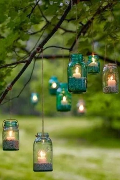 Colourful hanging jars are the perfect way to brighten up an outdoor space - especially a smaller space such as a backyard function - Indian wedding decor - modern Indian wedding - DIY wedding decor #thecrimsonbride