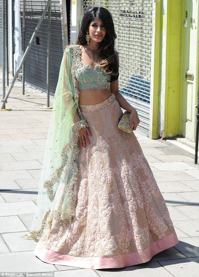 Hard at work: Jasmin Walia looked as though she was setting into her new show just fine as she and boyfriend Ross Worswick shot scenes for reality series Desi Rascals in Lewisham, London, on Sunday