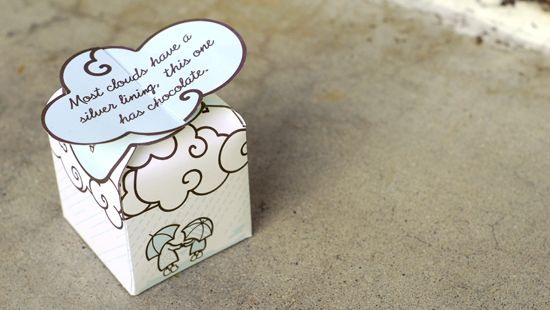 "A free printable box with the saying ""Most clouds have a silver lining, this one has chocolate."""
