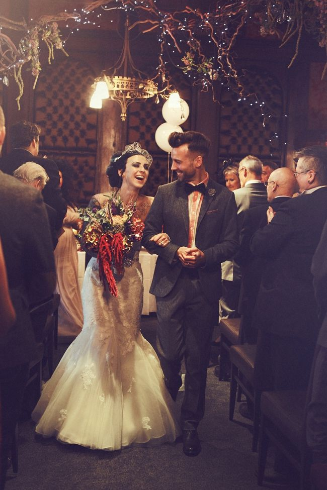 Walking up the aisle.  Sagas Of A Tattooed Bride – Swamps & Matt Got Married Copyright Claire Basiuk Photography http://marrymeink.co.uk/2014/01/03/sagas-of-a-tattooed-bride-swamps-matt-got-married/
