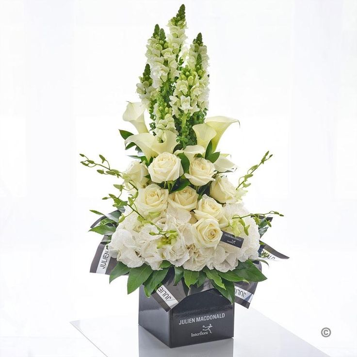 This sensational sculpted design brings together the finest quality flowers and cutting edge floral design to create an astonishing statement piece. Striking and contemporary, with a tall slender shape and a sense of grace and grandeur, this is an outstanding gift that will transform their home.