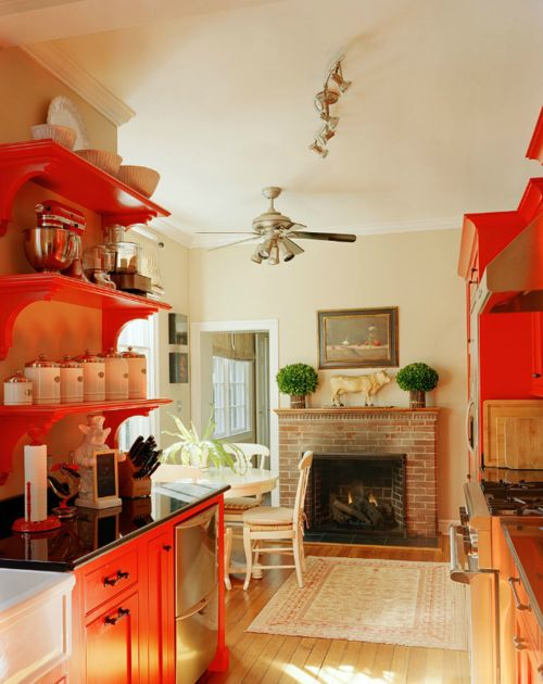 Love this, otherwise ordinary, galley kitchen, that now looks fabulous with red cabinetry,in an otherwise plain room. Pops of color are trending...