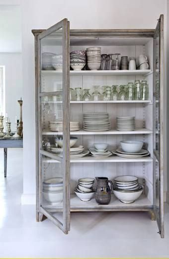 paint a bookcase and make some doors for it like this and paint the outside  Gives a shallow cupboard ideal for pretty china