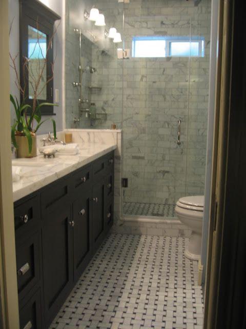 walk-in shower as end-cap to a long skinny bathroom