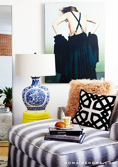Gorgeous sitting area for living room. Patterned seat, fun pillow, oversized painting.