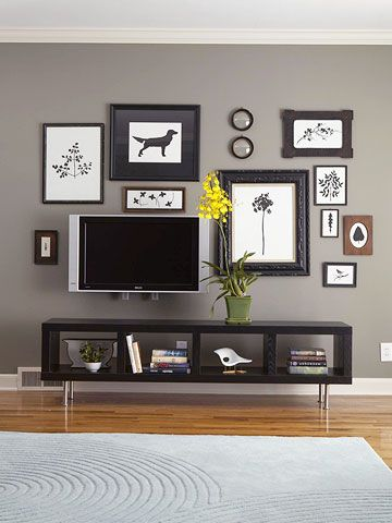 Can you spot the TV in this picture? It's creatively camouflaged by a wall of silhouette artwork.