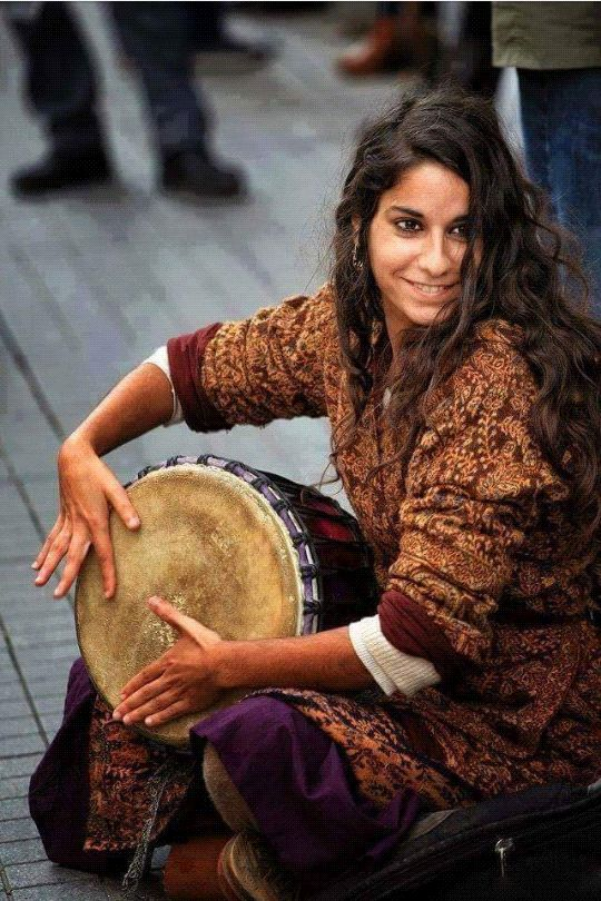 """Roma woman, rroma music. Ukraine, 2007. Did you know that the word """"gypsy"""" is a racial slur against the Roma people?"""
